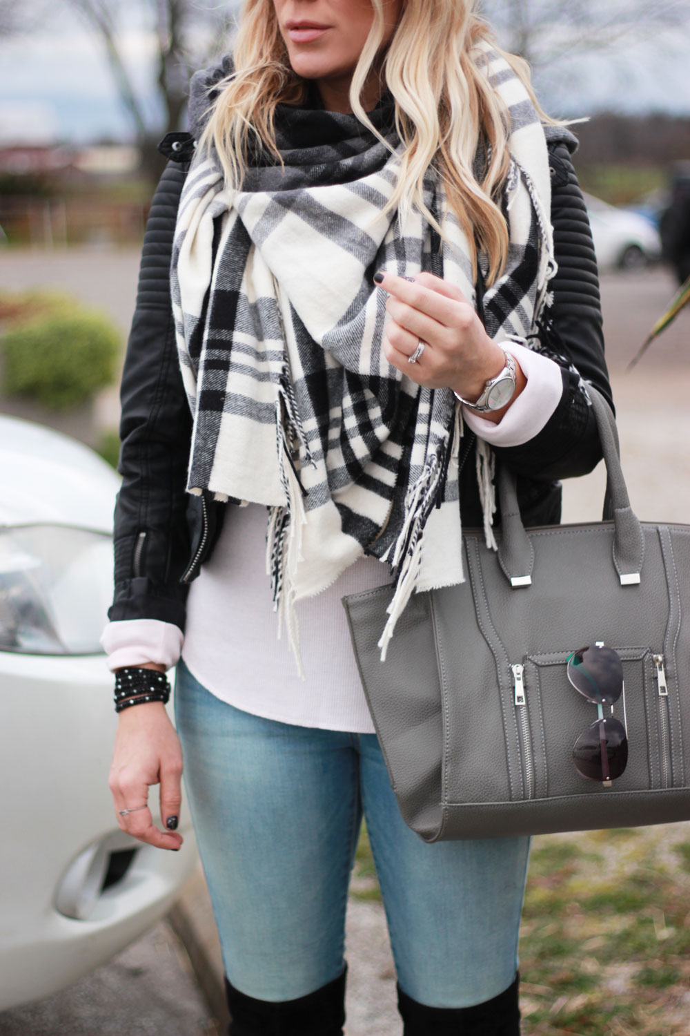 Leather jacket and blanket scarf