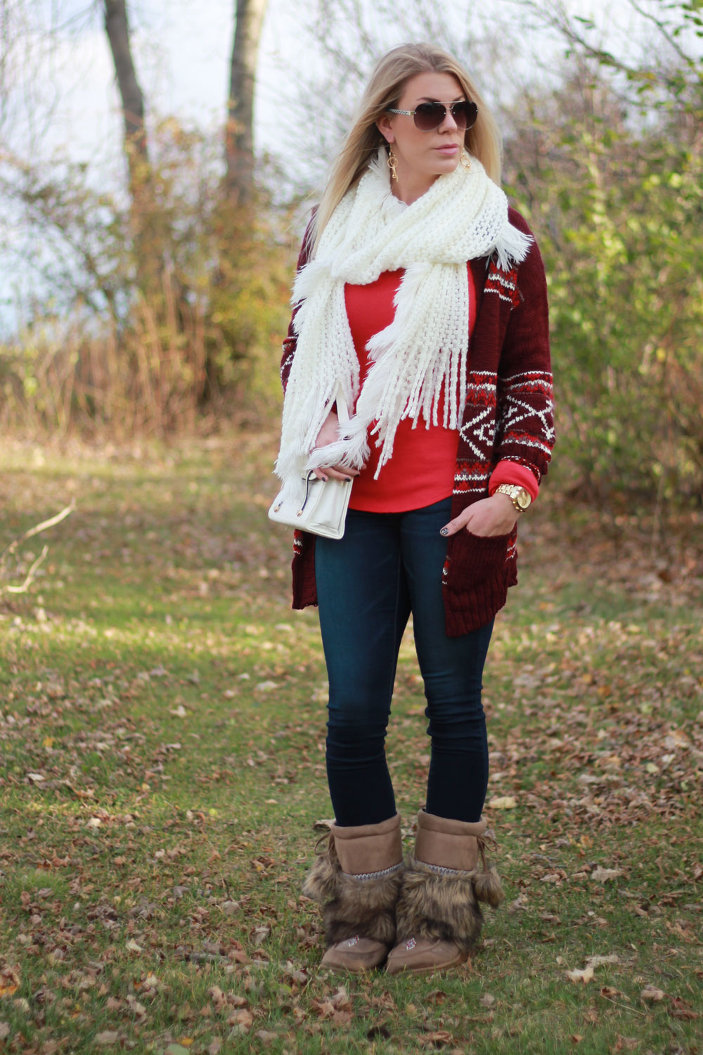 red cardi and fluffy boots